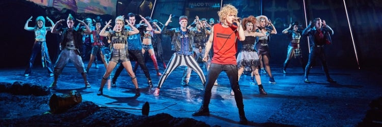 Andrew Polec and the company of Bat Out of Hell: The Musical