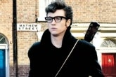 "Aaron Taylor-Johnson as John Lennon in the film ""Nowhere Boy"""