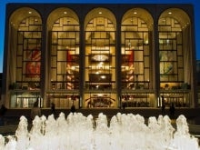 photo of the Metropolitan Opera House with a fountain in front of it